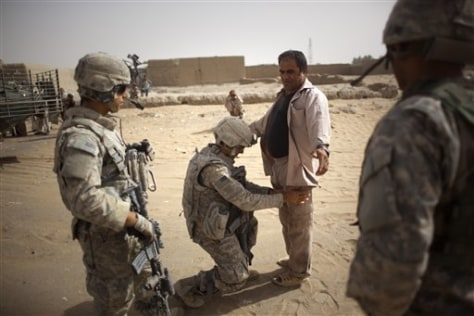 Image: Afghan man is searched by U.S. soldiers