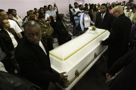IMAGE: CASKET OF SLAIN WOMAN