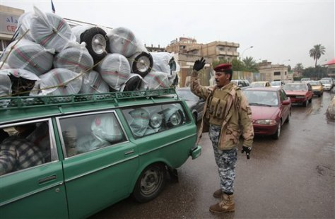 Image: Iraqi police officer lets loaded car pass