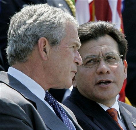 IMAGE: President Bush and Attorney General Alberto Gonzales