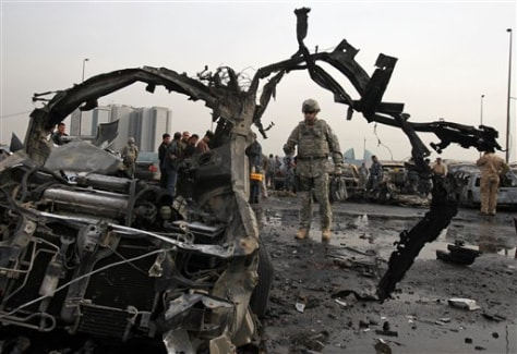 Image: U.S. soldier inspects bomb site