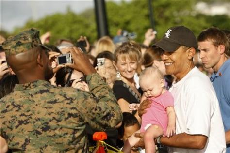Image: Obama holding baby