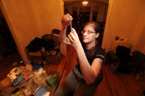 Image: Meredith L. Patterson conducts an experiment.