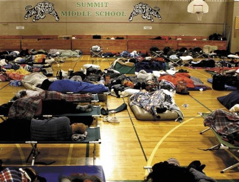 IMAGE: TRAVELERS IN SCHOOL GYM