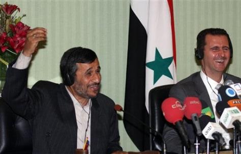 Image: Syrian president Bashar Assad andIranian president Mahmoud Ahmadinejad
