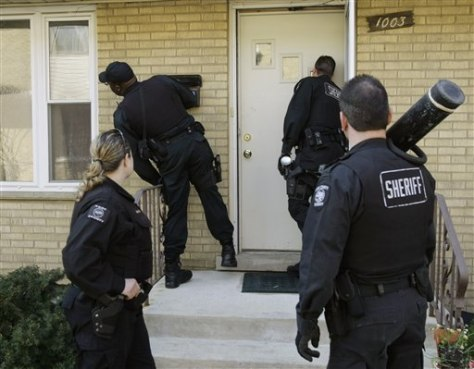 Image: Cook County deputies serve eviction notices
