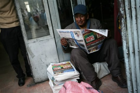 Image: Man reads newspaper