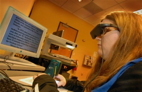 IMAGE: DISABLED STUDENT READS WITH VIDEO MAGNIFIER