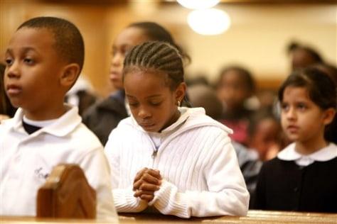 Image: Child prays for quake victims