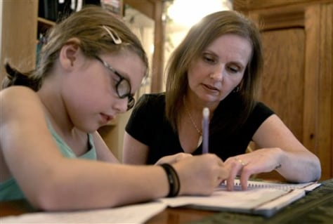 Image: Mother, daughter doing homework