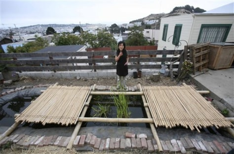 Image: Woman with pond filled with rainwater