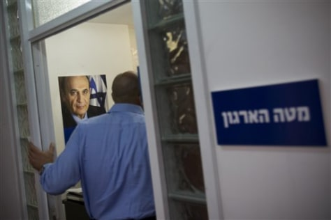 Image: Man enters Shaul Mofaz' office