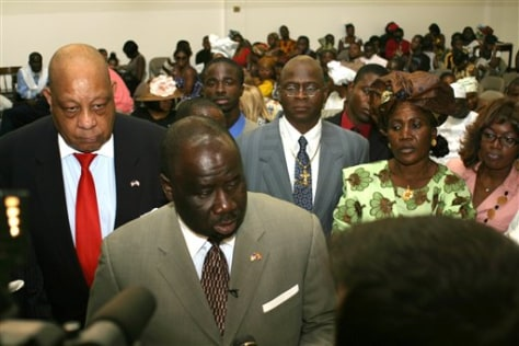 Image: Edwin Sele, Liberia's deputy ambassador to the United States, foreground left.