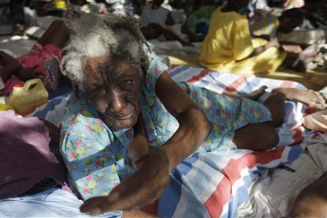 Image: Elderly Haitian woman begs for food