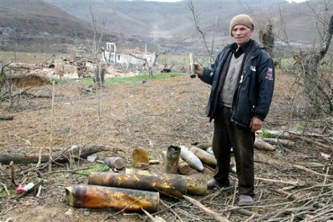 IMAGE: ALBANIAN WITH UNEXPLODED AMMO
