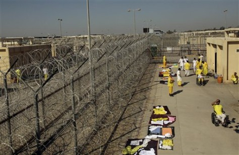 Image: Detainees outside cell blocks