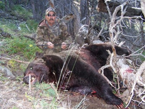 Image: Hunter with slain bear