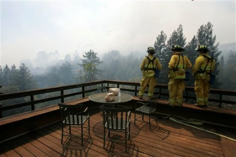 Image: Firefighters monitor wildfire