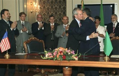 Image: U.S., Libyan envoy embrace