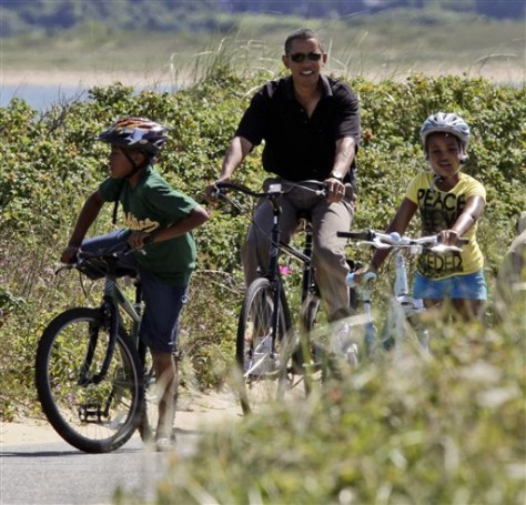 Image: President Barack Obama on bike ride with daughter Sasha, right, and friends.