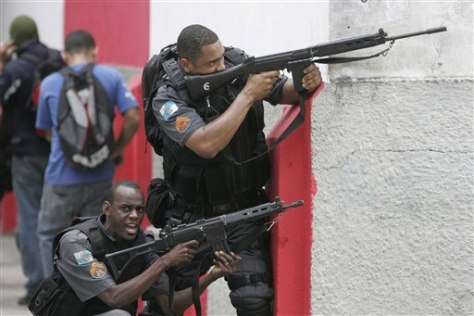 Image: Police in Rio aim their guns