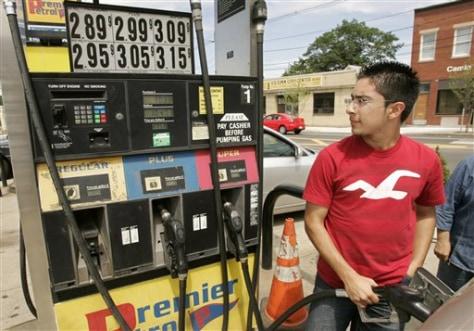 Jorge Gallego fills gas tank