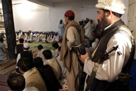 Image: Armed Taliban meet with town elders