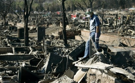 Image: Mobile home park resident stands on debris