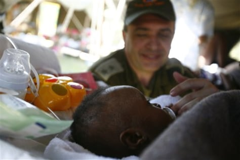 Image: Baby boy nursed by Avi Berman