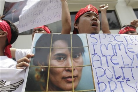Image: Protester with picture of Aung San Suu Kyi.