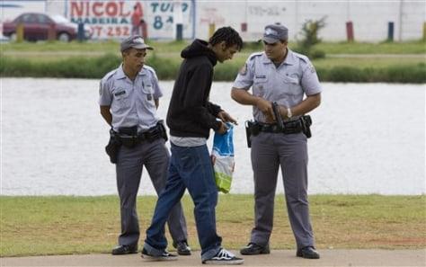 Image: Police officers stop a man