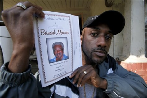 Image: Shaun Monroe with funeral program for his father.