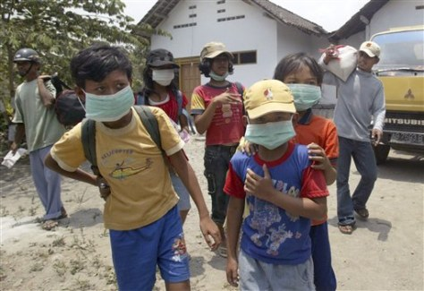IMAGE: CHILDREN WITH MASKS NEAR VOLCANO