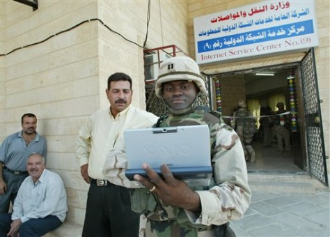 IMAGE: SOLDIER AT INTERNET SERVICE CENTER