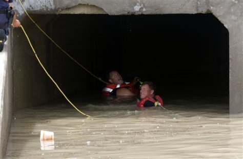 Image: Rescue workers search for flood victim