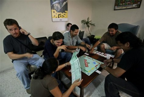 Image: Journalists play a board game