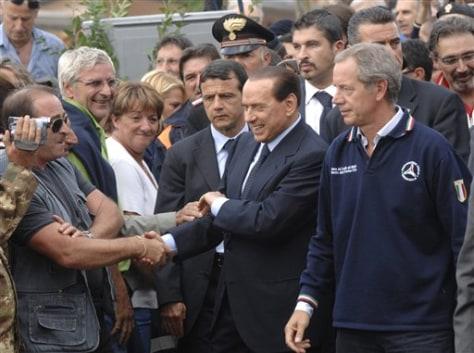 Image: Silvio Berlusconi with quake survivors