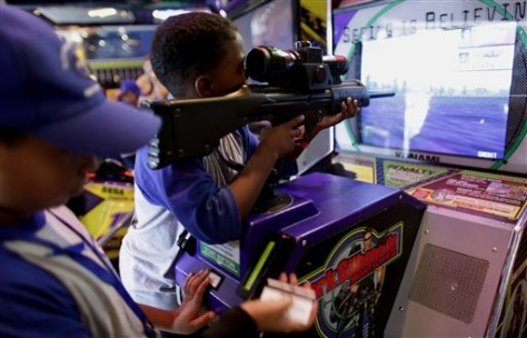 Image: Venezuelan boy using toy video game rifle