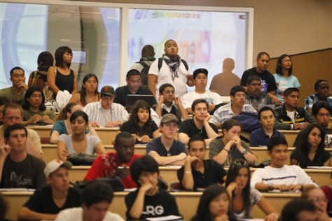 Image: Students stand in back row of a chemistry class