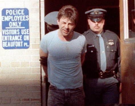 Image: Robert Koselik in handcuffs as a man