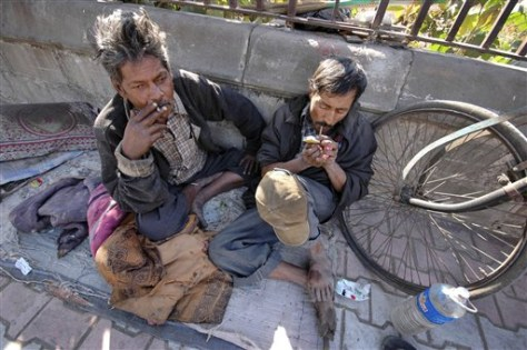 Image: Men smoking in India