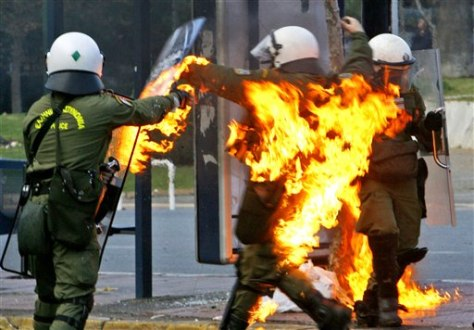 Image: Riot police officer on fire