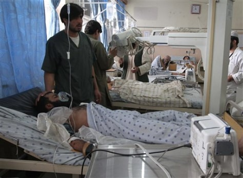 Image: Afghan victims of a suicide attack