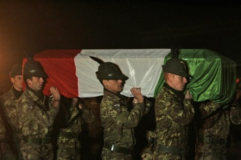 Image: Italian soldiers carry a coffin