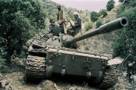 Image: Mujahedeen guerrillas on captured Russian T-55 tank in 1987