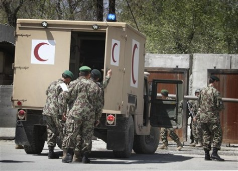 Image: Afghan soldiers check a military ambulance