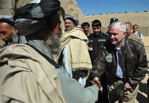 Image: US Defense Secretary Robert Gates, right, greets village elders