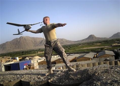 Image: Pfc. Joseph Robinson launches a drone