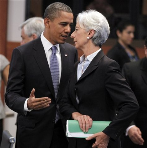 Image: President Barack Obama talks with International Monetary Fund Managing Director Christine Lagarde before the Asia-Pacific Economic Cooperation Summit leaders plenary session Sunday in Kapolei