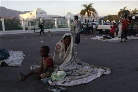 Image: A woman and her son wake up after spending the night on the street